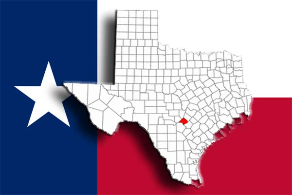 Comal County highlighted with the Texas flag in the background